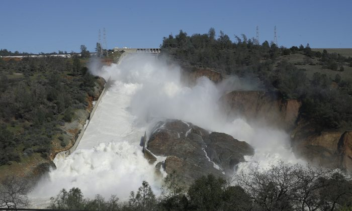 Water flows down Oroville Dam's main spillway near Oroville, Calif., Feb. 11, 2017. (AP Photo/Rich Pedroncelli)