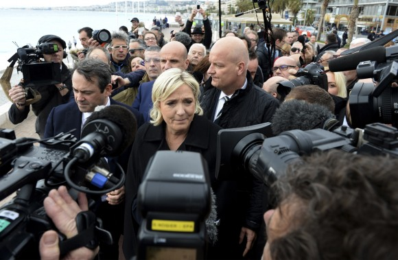 Far right leader and presidential candidate Marine Le Pen arrives to pay homage to the 86 victims of an attack last year, Monday Feb. 13, 2017 in Nice, southern France. Le Pen is zeroing in on two of her top priorities, security and immigration, in a visit to southeastern France. (AP Photo/Christian Alminana)