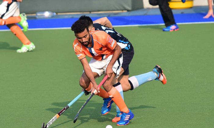 Khalsa's Sukhjeet Singh displayed amazing skills and agility during their match against HKFC at King's Park on Sunday Feb 12, 2017. (Bill Cox/Epoch Times).