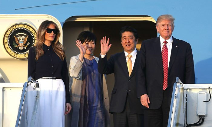 President Donald Trump and his wife, Melania, arrive with Japanese Prime Minister Shinzo Abe and his wife, Akie, on Air Force One at the Palm Beach International airport as they prepare to spend part of the weekend together at Mar-a-Lago resort in West Palm Beach, Florida on Feb. 10, 2017. (Joe Raedle/Getty Images)