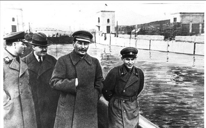 Kliment Voroshilov (L), Vyacheslav Molotov, Joseph Stalin and Nikolai Yezhov (R) at the shore of the Moscow-Volga canal in this file photo. Molotov fought to gain power after Stalin's death in 1953 while Yezhov was tried and executed in 1940.  (Wikipedia Commons)