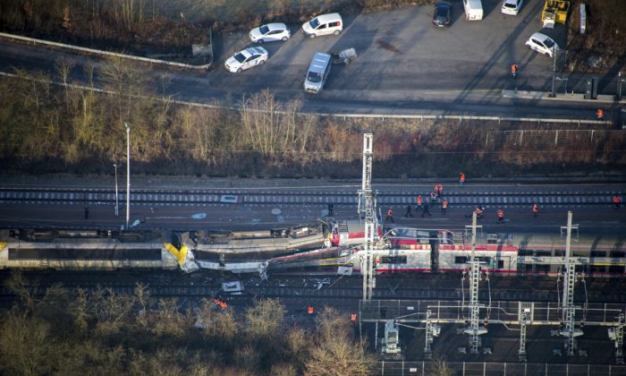 In this image provided by the Luxembourg Police Grand Ducale, an aerial view of the wreckage of a passenger train and a freight train after they collided in Bettemberg, Luxembourg on Feb. 14, 2017. (Luxembourg Police Grand Ducale via AP)