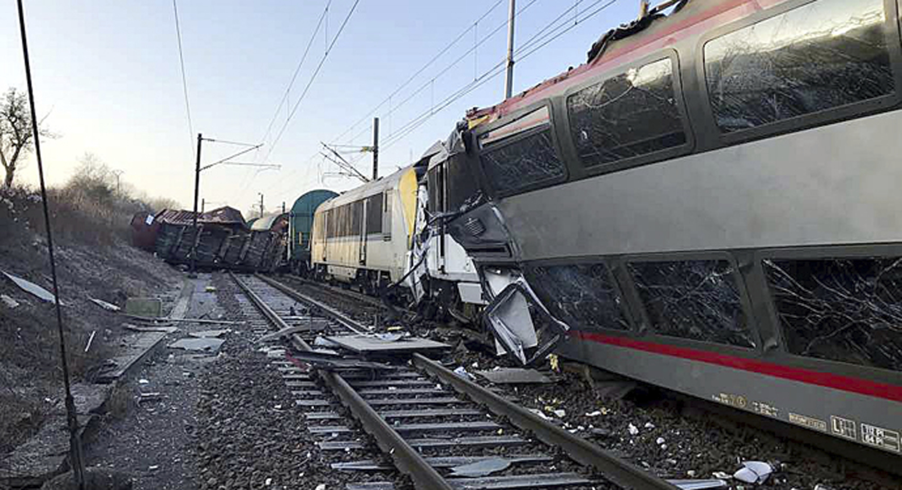 In this image provided by the Luxembourg Police Grand Ducale, the wreckage of a passenger train and a freight train after they collided in Bettemberg, Luxembourg on Feb. 14, 2017. (Luxembourg Police Grand Ducale via AP)