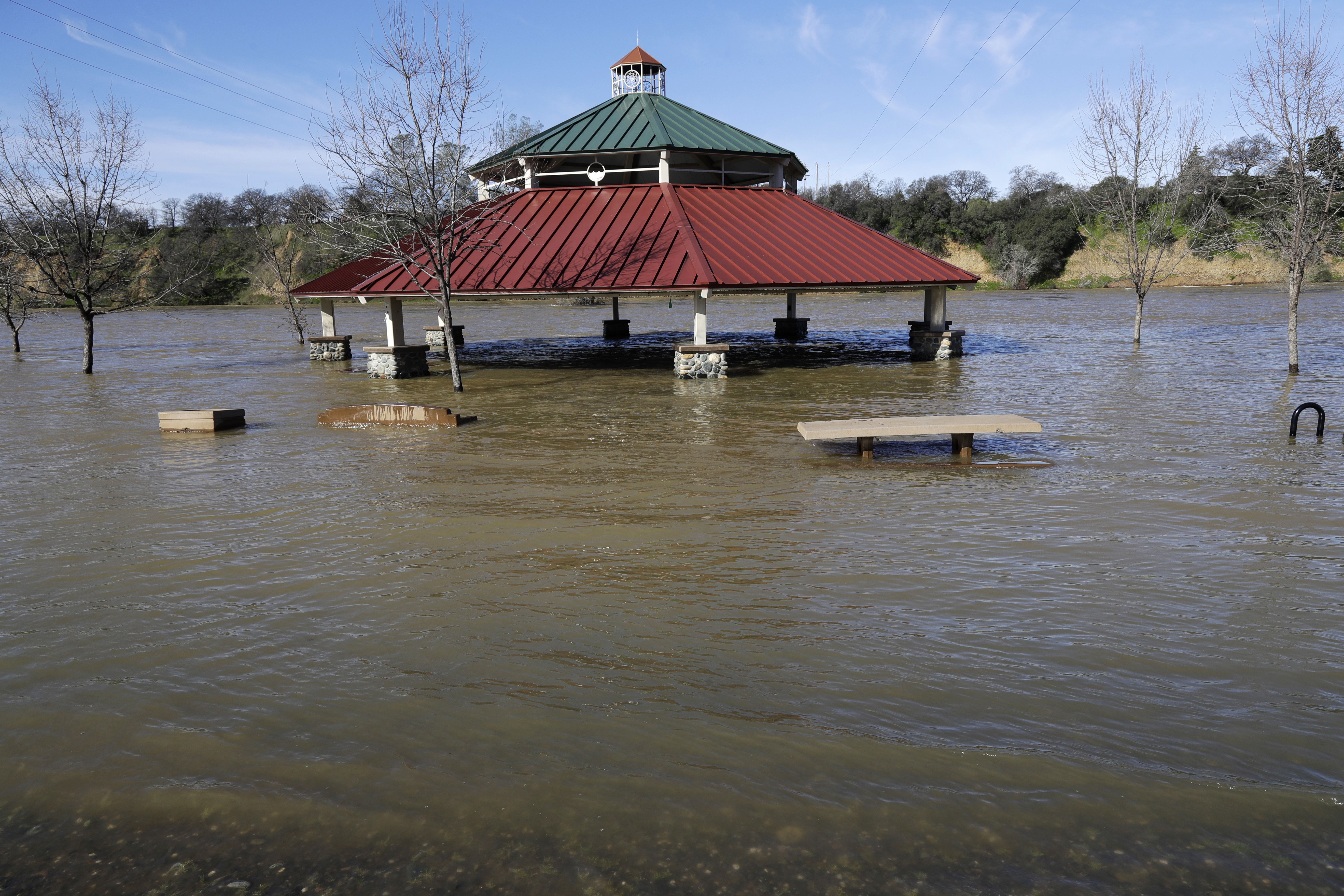 A gazebo is submerged from the overflowing Feather River downstream from a damaged dam at Riverbend Park in Oroville, Calif., on Feb. 14, 2017. (AP Photo/Marcio Jose Sanchez)