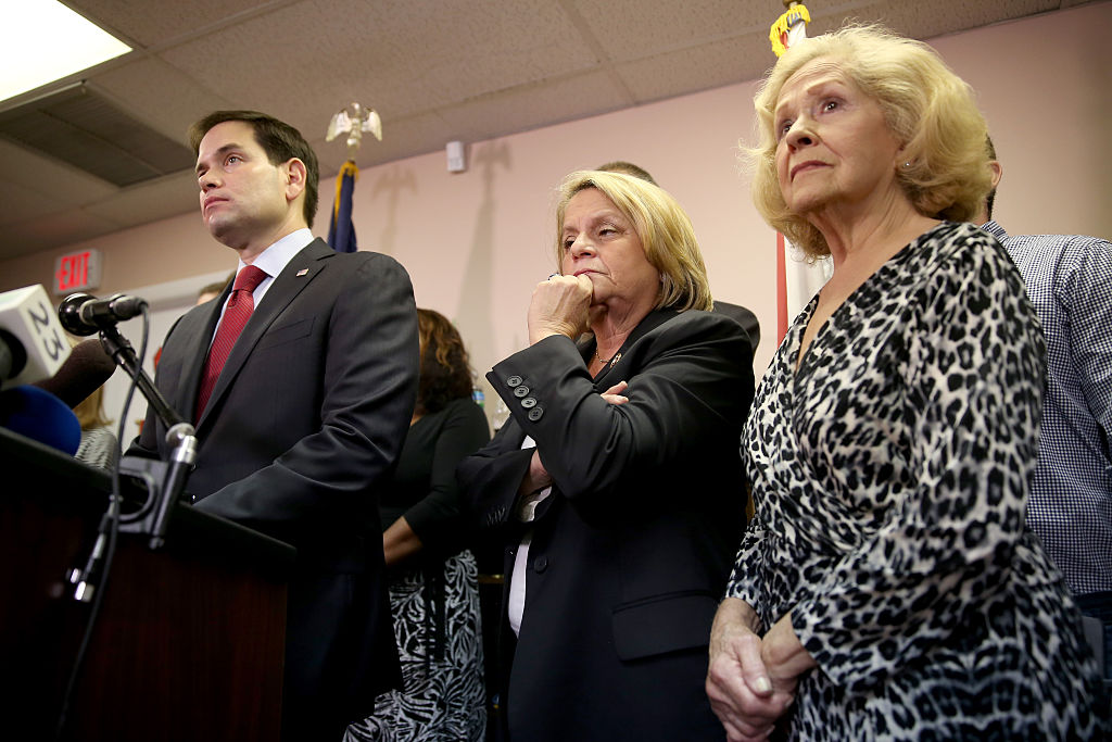 Sen. Marco Rubio (R-FL) (L) speaks to the media as he is joined by Rep. Ileana Ros-Lehtinen (R-FL) (C) and Mirta Costa the mother of Carlos Costa, a pilot from a group called 'Brothers to the Rescue' who was shot down by Cuban fighter jets in 1996, as they addressed the decision by President Barack Obama to change the United States Cuba policy in Miami, FL., on Dec. 18, 2014.