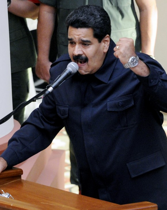 Venezuelan President Nicolas Maduro delivers a speech during a ceremony within commemorations for the late President Hugo Chavez's death first anniversary, at the Cuartel de la Montana in Caracas on March 5, 2014. (LEO RAMIREZ/AFP/Getty Images)