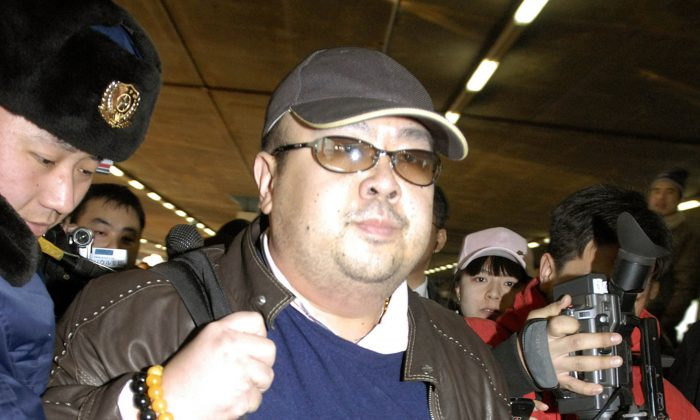 In this file photo, a man believed to be Kim Jong Nam, eldest son of then North Korean leader Kim Jong Il, is surrounded by the media upon arrival from Macau at Beijing airport in Beijing. (Kyodo News via AP)