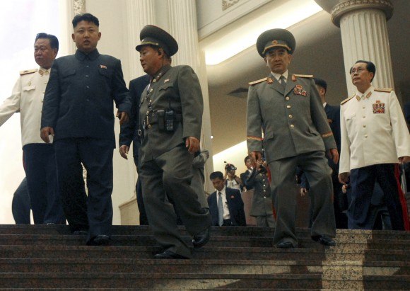 In this file photo, North Korean leader Kim Jong Un, second left, tours the newly-opened Fatherland Liberation War Museum, with his uncle Jang Song Thaek, right, Yang Hyong Sop, second right, vice president of the Presidium of North Korea's parliament, and Vice Marshal Choe Ryong Hae, left, as part of celebrations for the 60th anniversary of the Korean War armistice in Pyongyang. (AP Photo/Wong Maye-E)