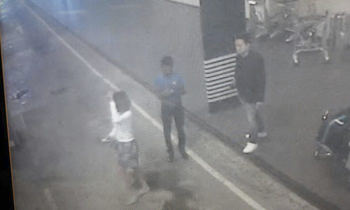 This image provided by Star TV on Wednesday, Feb. 15, 2017, of closed circuit television footage from Monday, Feb 13, 2017, shows a woman (L) at Kuala Lumpur International Airport in Sepang, Malaysia, who police say was arrested Wednesday in connection with the death of Kim Jong Nam, the half brother of North Korean leader Kim Jong Un. (Star TV via AP)