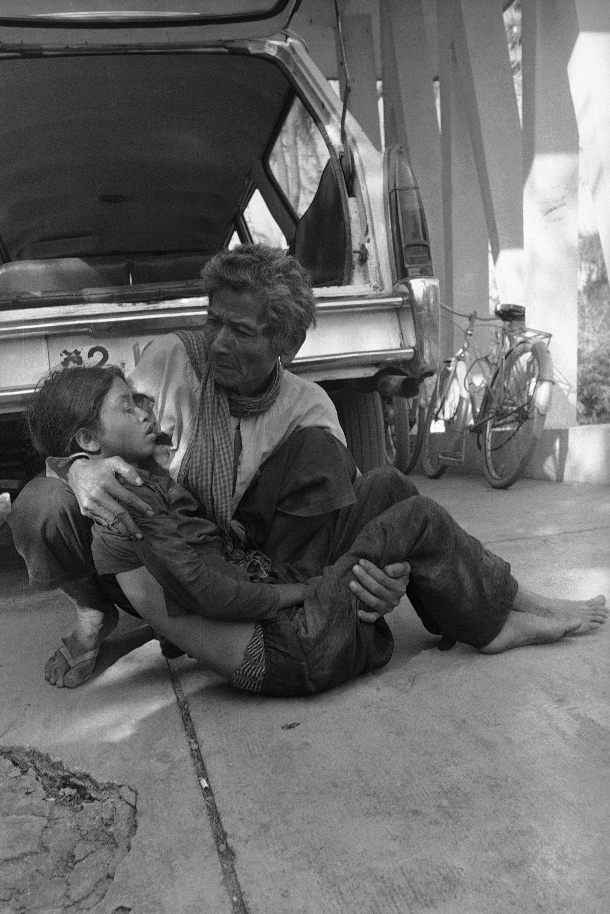 A Cambodian cries as he holds his dead daughter killed when Khmer Rouge insurgents sheiled Prek Phnau, eight miles North of Phnom Penh in Cambodia an. 10, 1974. (AP Photo/Chor Yuthy)