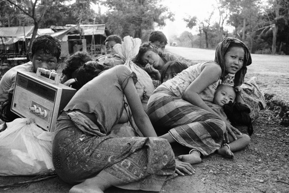Cambodian women and children huddle close together in fear of incoming fire from Khmer Rouge forces of Highway 5, just northwest of Phnom Penh, April 6, 1975. (AP Photo)