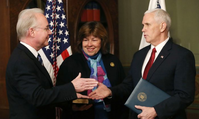 U.S. Vice President Mike Pence (R) shakes hands with Rep. Tom Price (R-GA)(L) after swearing him in as the new Health and Human Services Secretary, as his wife Betty Price looks on,  in Washington, DC. on Feb. 10, 2017. (Mark Wilson/Getty Images)