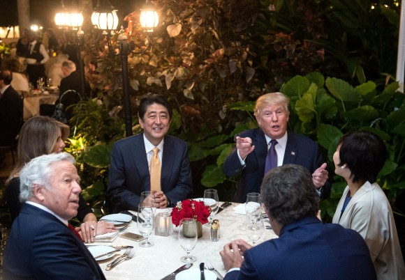 President Donald Trump, Japanese Prime Minister Shinzo Abe (2nd-L), his wife Akie Abe (R), US First Lady Melania Trump (L) and Robert Kraft (2nd-L),owner of the New England Patriots, sit down for dinner at Trump's Mar-a-Lago resort on Feb. 10, 2017. (NICHOLAS KAMM/AFP/Getty Images)
