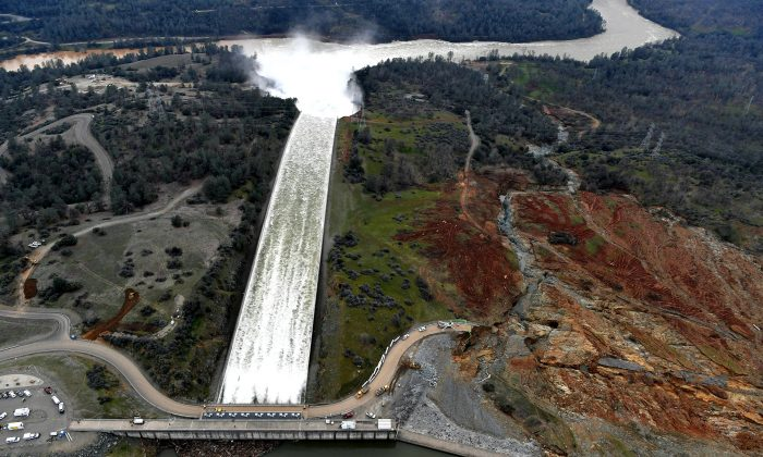 The Oroville Dam spillway releases 100,000 cubic feet of water per second down the main spillway in Oroville, California on Feb. 13, 2017. (JOSH EDELSON/AFP/Getty Images)