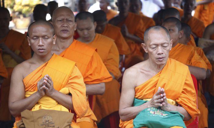 Buddhist monks pray inside the Wat Dhammakaya temple in Pathum Thani province, Thailand, on Feb. 16, 2017. (AP Photo/Sakchai Lalit)