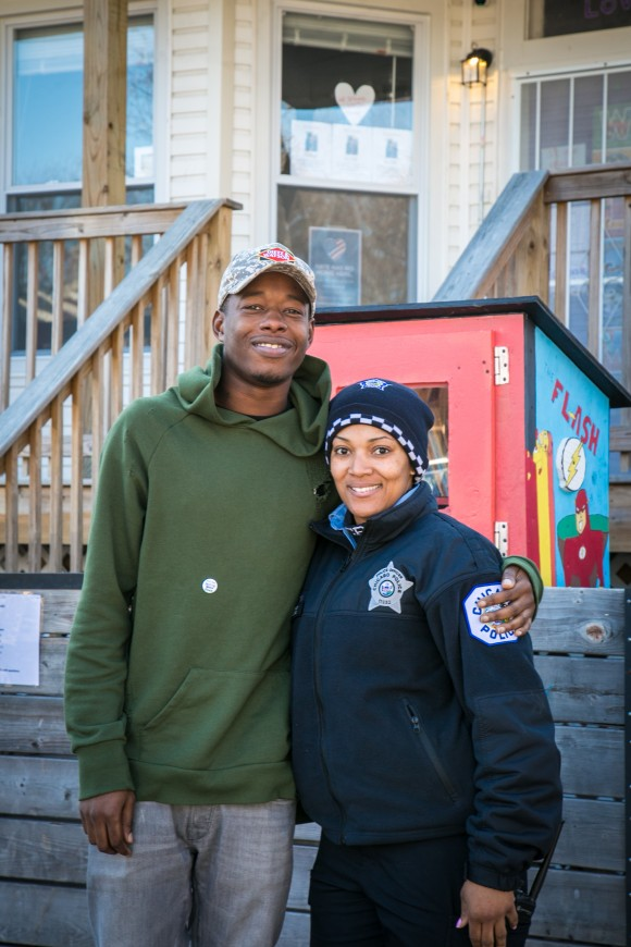 Karl Mables with Officer Janice Wilson in front of the I Grow Chicago Peace House which has free supplies, food, and offers classes for children in Englewood, Chicago, on Feb. 3, 2017. Mables was a former gang member who is now preparing to enlist in the Chicago Police Department. (Benjamin Chasteen/Epoch Times)