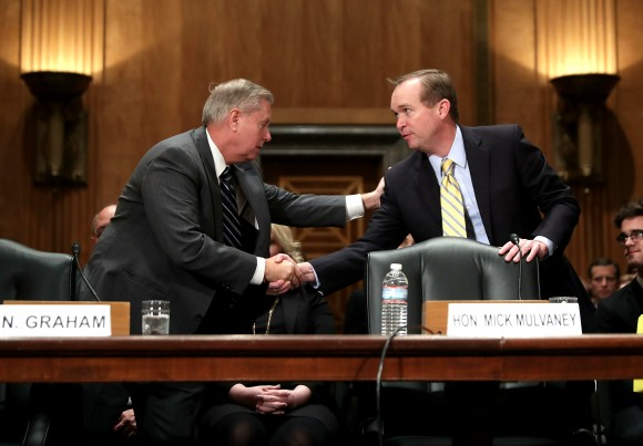 Sen. Lindsey Graham (R-SC) (L) shakes hands with Rep. Mick Mulvaney (R-SC) after introducing him before the Senate Homeland Security and Governmental Affairs Committee during Mulvaney's confirmation hearing to be the next director of the Office of Management and Budget in the Dirksen Senate Office Building on Capitol Hill in Washington on Jan. 24, 2017. A conservative Republican from South Carolina, Mulvaney was nominated by U.S. President Donald Trump. (Chip Somodevilla/Getty Images)