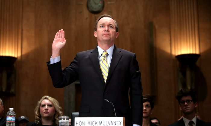 Rep. Mick Mulvaney (R-SC) is sworn in before the Senate Homeland Security and Governmental Affairs Committee during his confirmation hearing to be the next director of the Office of Management and Budget in the Dirksen Senate Office Building on Capitol Hill January 24, 2017 in Washington, DC. A conservative Republican from South Carolina, Mulvaney was nominated by U.S. President Donald Trump. (Photo by Chip Somodevilla/Getty Images)