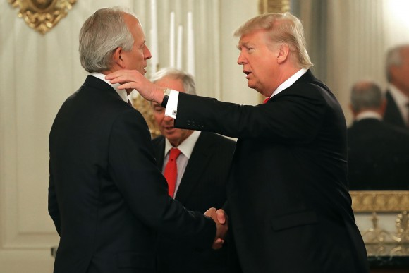 President Donald Trump (R) greets Boeing Chairman James McNerney at the beginning of a policy forum in the State Dining Room at the White House  in Washington on Feb. 3, 2017. (Chip Somodevilla/Getty Images)
