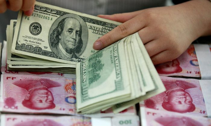The duality conundrum of the Chinese currency is intriguing but can be explained using the plunging elevator theory. (Epoch Times)