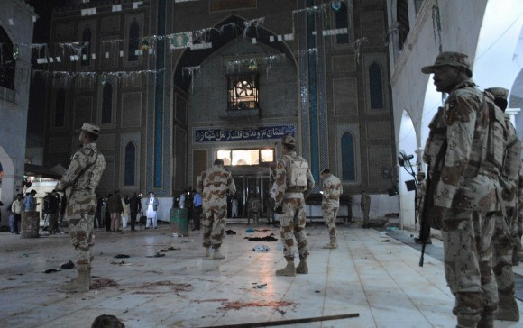 Pakistani para-military soldiers stand alert after a deadly suicide attack at the shrine of famous Sufi Lal Shahbaz Qalandar in Sehwan, Pakistan, on Feb. 16, 2017. (AP Photo/Pervez Masih)