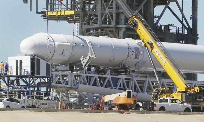 A Space X Falcon9 rocket is readied for launch Friday, Feb. 17, 2017, at Launch Complex 39A  at the Kennedy Space Center in Cape Canaveral, Fla. Saturday morning's planned launch will be SpaceX's first from Florida since a rocket explosion at another pad last summer. (Red Huber/Orlando Sentinel via AP)