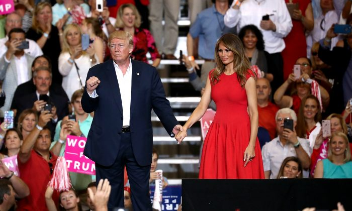 President Donald Trump and Melania Trump stand together during a campaign rally at the AeroMod International hangar at Orlando Melbourne International Airport in Melbourne, Florida on Feb. 18, 2017. President Trump is holding his rally as he continues to try to push his agenda through in Washington, DC. (Joe Raedle/Getty Images)
