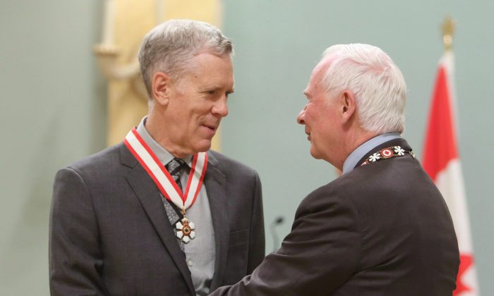 Author and humorist Stuart McLean is presented with the Officer of the Order of Canada medal by Gov. Gen. David Johnston in Ottawa on Sept. 28, 2012. (THE CANADIAN PRESS/Fred Chartrand)