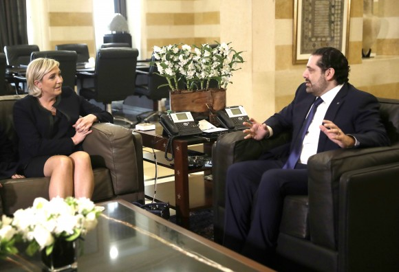 Lebanese prime minister Saad Hariri (R) meets with French National Front leader and presidential candidate Marine Le Pen, left, at the government palace, in Beirut, Lebanon on Feb. 20, 2017. (AP Photo/Hussein Malla)