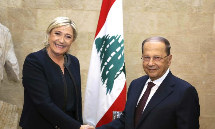 French National Front leader and presidential candidate Marine Le Pen (L) shakes hands with Lebanese President Michel Aoun, at the presidential palace, in Baabda, east Beirut, Lebanon on Feb. 20, 2017. Le Pen has arrived in Beirut to meet with the Lebanese head of state and leading Christian figures. The National Front leader is hoping to burnish her credentials as a defender of Christians in the Middle East, ahead of France's April 23 presidential elections. (Dalati Nohra via AP)