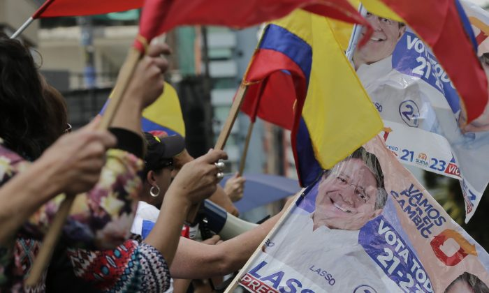 Opposition presidential candidate Guillermo Lasso's supporters protest outside Ecuador's National Electoral Council to demand the official results of the presidential elections, in Quito, Ecuador on Feb. 20, 2017. (AP Photo/Dolores Ochoa)