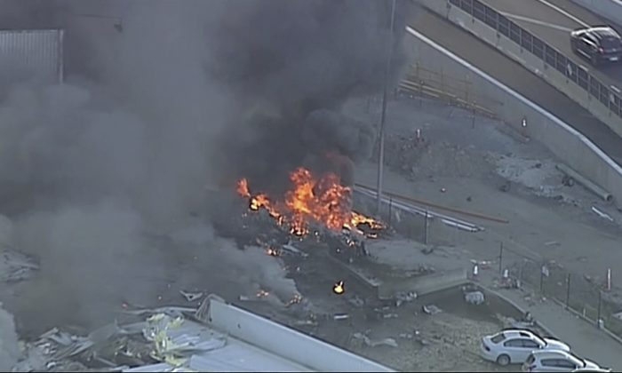 This image made from video shows the site of a plane crash at Essendon Airport in Melbourne, Australia on Feb. 21, 2017. (Channel 9 via AP)