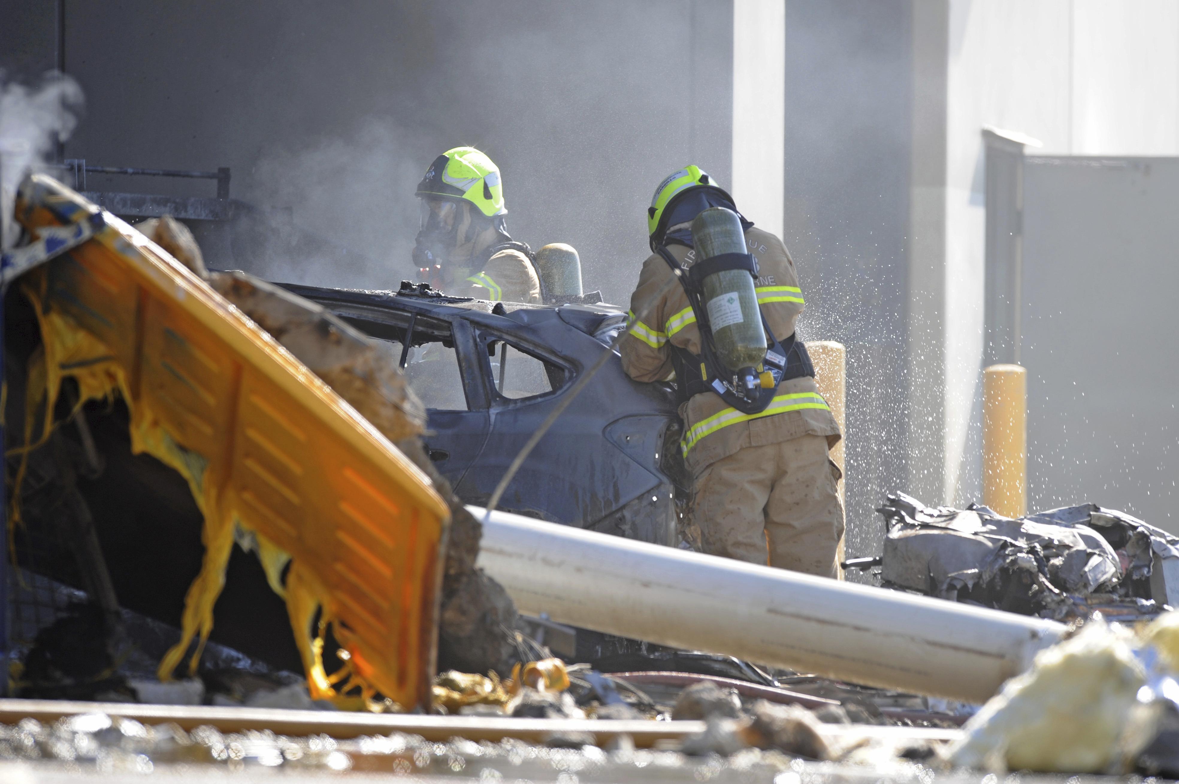 Emergency personnel work at a light plane crashed in Melbourne, Australia on Feb. 21, 2017. (Joe Castro/AAP Image via AP)