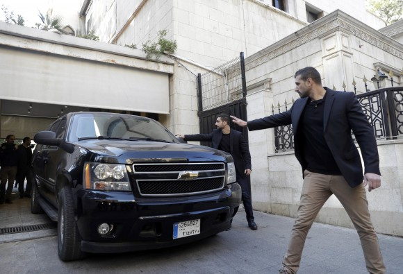 Body guards escort a vehicle that carries French right-wing presidential candidate Marine Le Pen, as she leaves Dar al-Fatwa building the headquarters of the Sunni Mufti, after she refused to wear a head scarf to meet with of Lebanon's Grand Mufti Sheikh Abdel-Latif Derian, in Beirut, Lebanon on Feb. 21, 2017. (AP Photo/Hussein Malla)