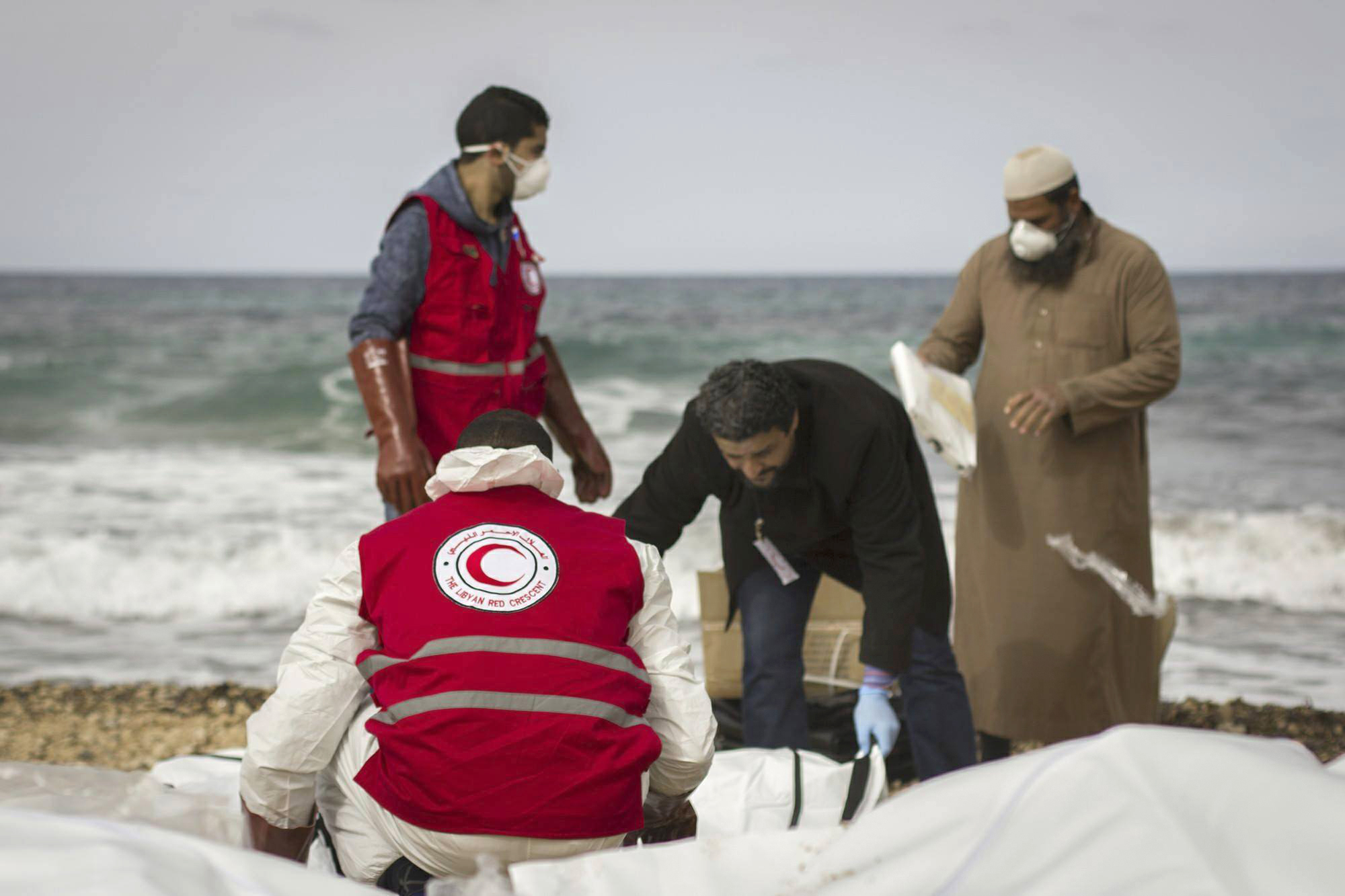 Libyan Red Crescent workers recovering bodies of people that washed ashore, near Zawiya, Libya on Feb. 20, 2017.(Mohannad Karima/IFRC via AP)