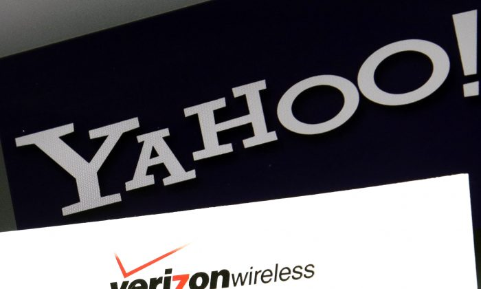 Yahoo and Verizon logos on a laptop, in North Andover, Mass. (AP Photo/Elise Amendola)