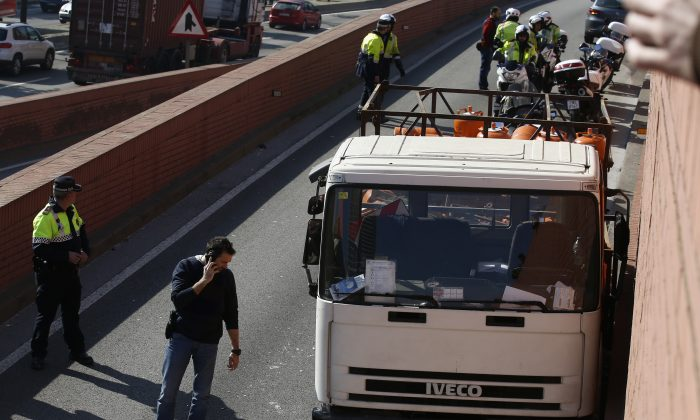 Police officers inspect a truck after an incident, in Barcelona, Spain on Feb. 21, 2017. (AP Photo/Manu Fernandez)