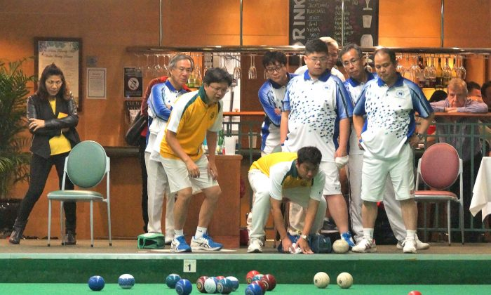 In the last end between Hong Kong Football Club's Warren Cheung and Craigengower Cricket Club 's Kevin Fung (not in photo), Fung used his last shot (red on right) to take out HKFC's two second shots (the two white bowls on the right) and won four shots in this end. Despite losing the game 20-14, the win in the last end allowed CCC to win the aggregate to take home six points. (Mike Worth)