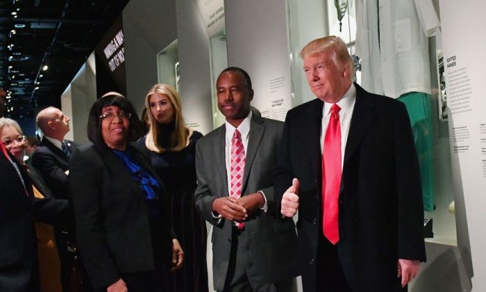 President Donald Trump and Housing and Urban Development nominee Ben Carson pose in front of the Ben Carson exhibit during a visit to the Smithsonian National Museum of African American History and Culture in Washington, DC. on Feb. 21, 2017.  (Kevin Dietsch - Pool/Getty Images)