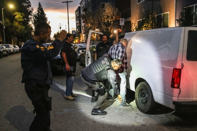 A man is detained by Immigration and Customs Enforcement (ICE), agents in Los Angeles on Oct. 15, 2015.  (John Moore/Getty Images)