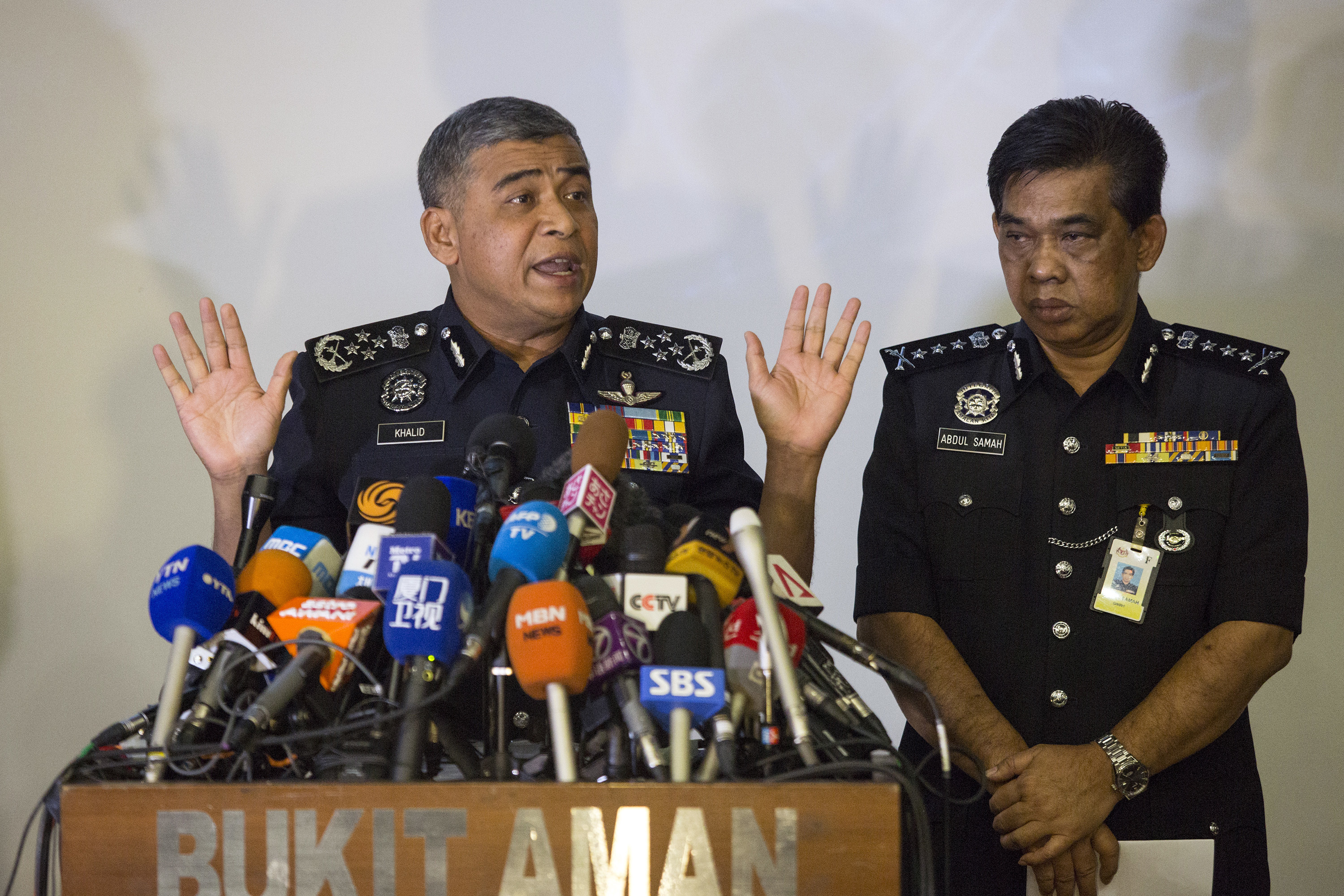 Malaysia's Inspector-General of Police Khalid Abu Bakar (L) and Selangor Police Chief Abdul Samah Mat during a press conference at the Bukit Aman national police headquarters in Kuala Lumpur, Malaysia on Feb. 22, 2017. (AP Photo/Alexandra Radu)
