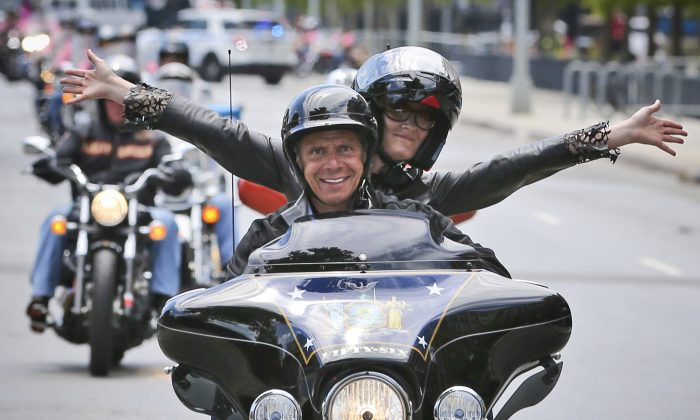 New York Gov. Andrew Cuomo and his girlfriend Sandra Lee ride in a breast cancer awareness motorcycle event in New York on June 27, 2016. (AP Photo/Seth Wenig)