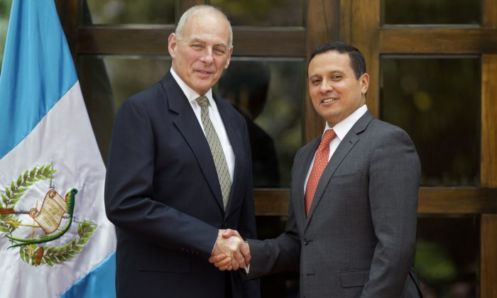 U.S. Secretary of Homeland Security John F. Kelly (L) shakes hands with Guatemala's Foreign Minister Carlos Morales, during a photo opportunity at the Foreign Affairs Ministry in Guatemala City on Feb. 22, 2017. (AP Photo/Luis Soto)