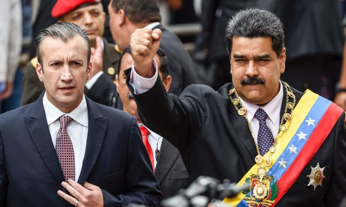 Venezuelan President Nicolas Maduro (R) and Vicepresident Tareck El Aissami greet supporters before the ceremony where Maduro gave a speech reviewing his year in office at the Supreme Court of Justice in Caracas on Jan. 15, 2017.  (JUAN BARRETO/AFP/Getty Images)