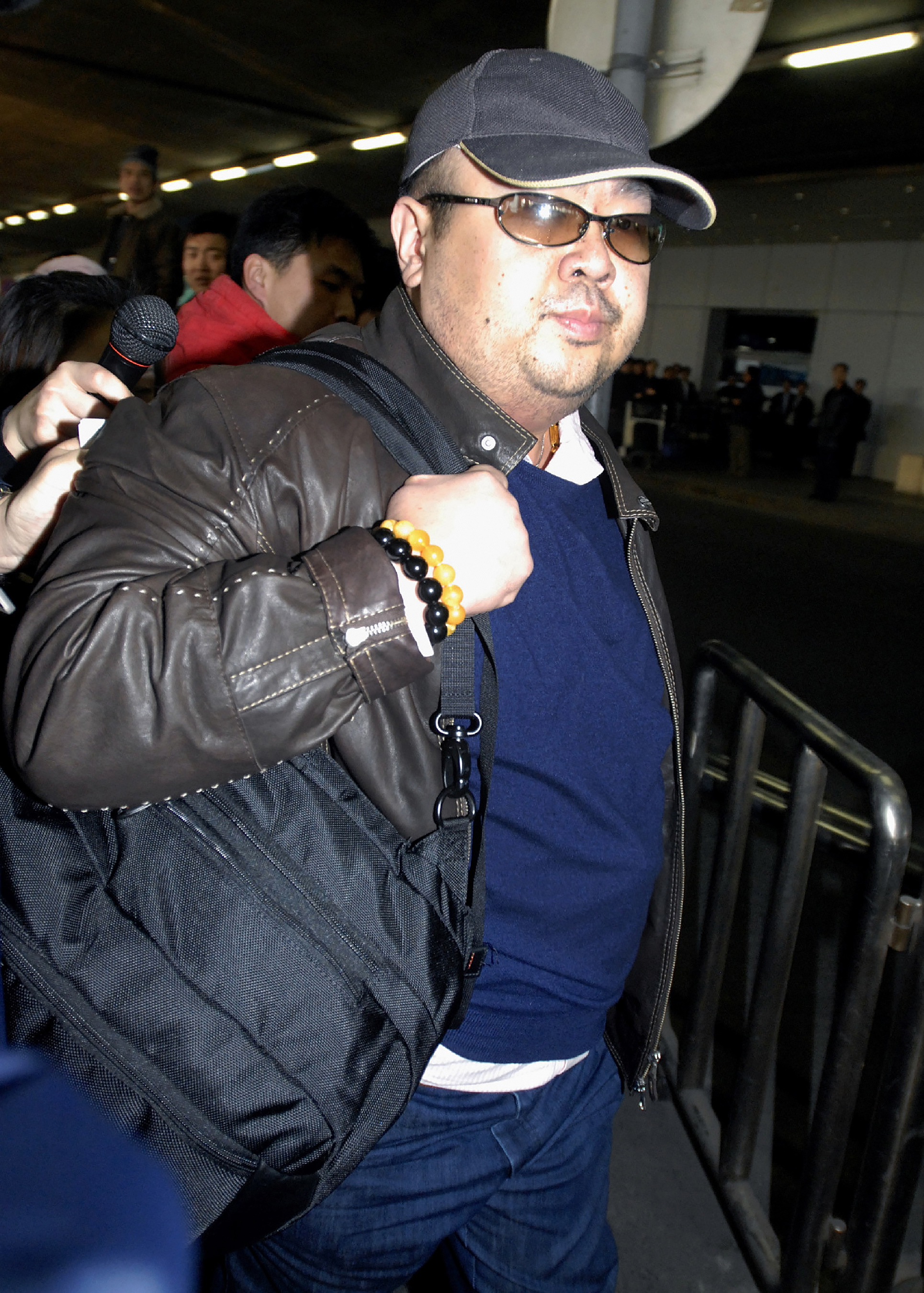 Former North Korean leader Kim Jong-Il's eldest son, Kim Jong-Nam, walking amongst journalists upon his arrival at Beijing's international airport on Feb. 11, 2007. (JIJI PRESS/AFP/Getty Images)