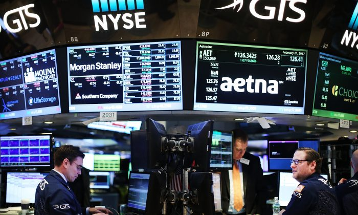 Traders work on the floor of the New York Stock Exchange on Feb. 21, 2017. (Spencer Platt/Getty Images)