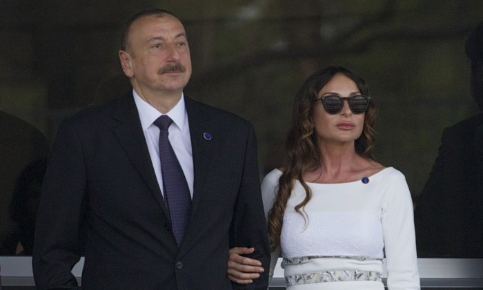 Azerbaijan's President Ilham Aliyev and his wife Mehriban Aliyeva watch the last minutes of the Formula One Grand Prix of Europe at the Baku Circuit in Baku, Azerbaijan on June 19, 2016. (AP Photo/Ivan Sekretarev)