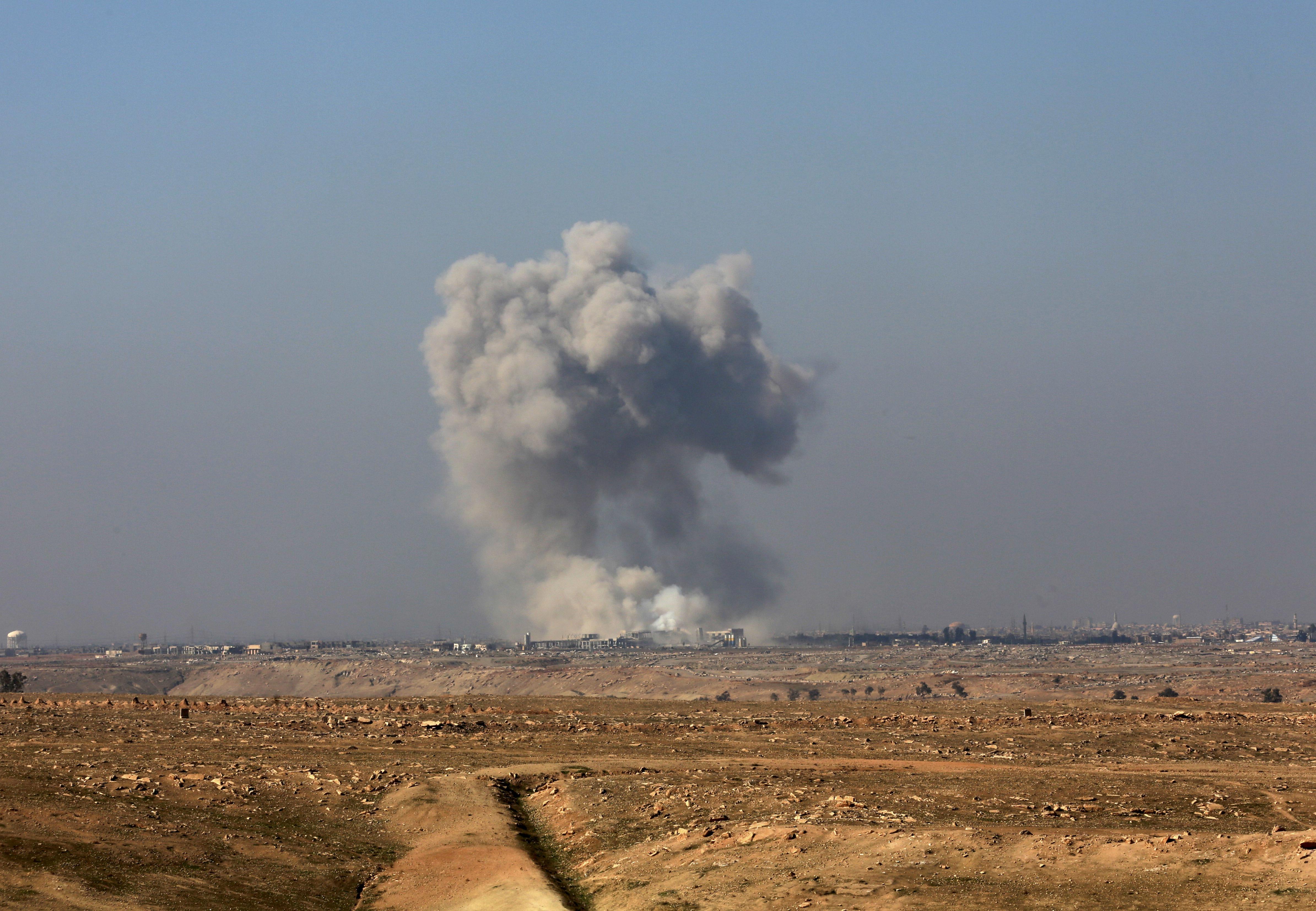 Smoke rises from the western side of Mosul following a U.S.-led coalition airstrike, in Abu Saif, outside the western side of Mosul, Iraq on Feb. 22, 2017. (AP Photo/ Khalid Mohammed)