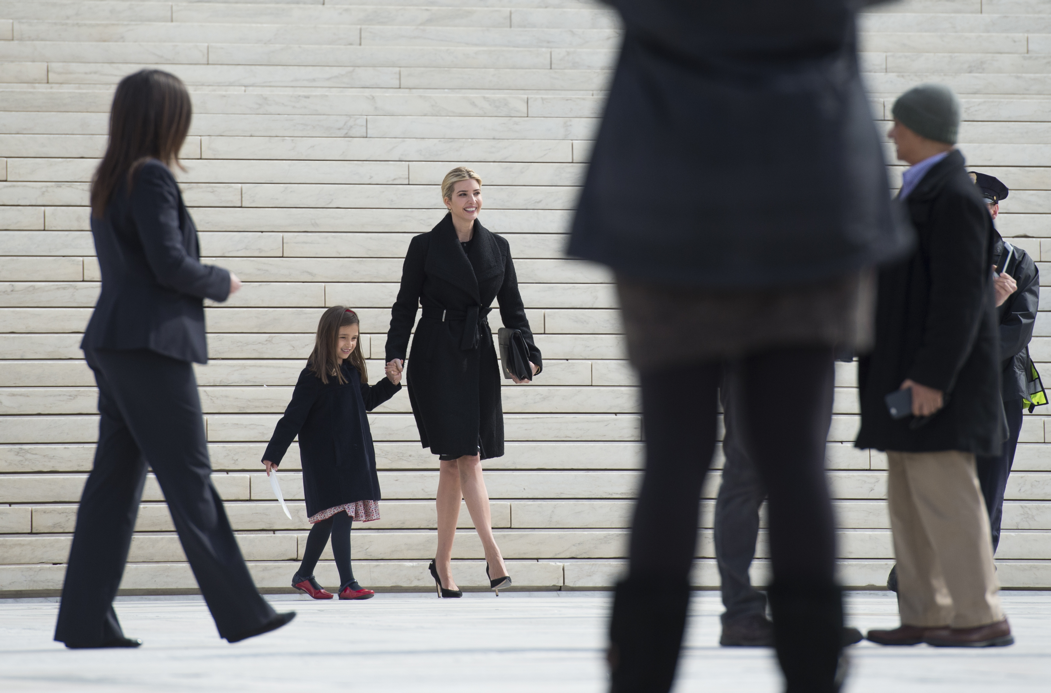 Ivanka Trump and her daughter Arabella Kushner walk down the steps of the Supreme Court in Washington on Feb. 22, 2017. (AP Photo/Molly Riley)