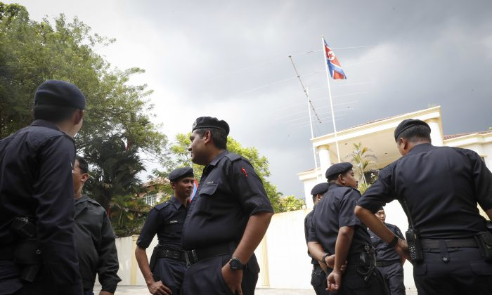 Malaysian Police stand outside North Korean Embassy in Kuala Lumpur, Malaysia on Feb. 23, 2017. (AP Photo/Vincent Thian)